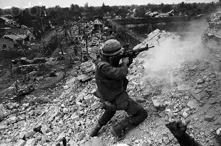 https://flic.kr/p/fZh84E | 16 Feb 1968, Hue, South Vietnam | 16 Feb 1968, Hue, South Vietnam --- A U. S. Marine fires his M-16 over the crest of the wall near the Citadel of Hue after fighting for hours to gain the top.  The battle for Hue has already run 18 days and the Communist apparently intend to hold out to the last man. --- Image by © Bettmann/CORBIS