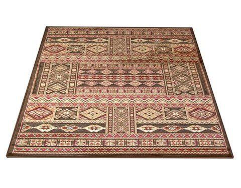 Medallion-matto, ruskea. Itämaistyylinen matto. Lyhyt nukka, sileä ja pehmeä pinta.