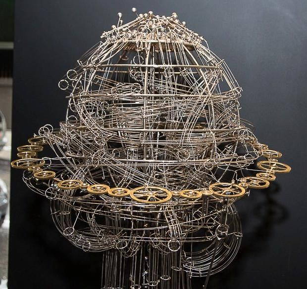 Die Sieben.  Kinetic Sculpture with 16 different chimes, 16 passageways where tiny steel balls move, touching 16 pentatonic cylinders and 47 gears.   Miki Eleta, artist