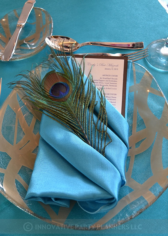 Peacock Feather and menu in fun napkin fold.  Designed by Innovative Party Planners.  Linen by Gala Clothes.