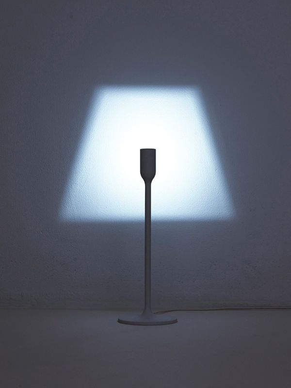 A lampshade made from light Japanese design unit YOY (previously) has given new light to what was previously an outdated, dust-covered concept. The minimal lamp has a head embedded with an LED light. A carved out socket casts a glow of light that's shaped like a lamp shade that, most certainly, makes the lamp. It comes in two form, a table and floor lamp, and is debuting at the 2014 Milano Salone