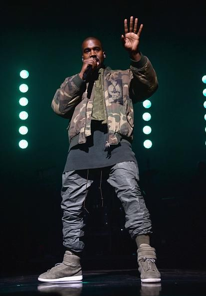 Kanye West Wears Raf Simons Camo Jacket and Martin Margiela Sneakers for Pre Super Bowl Performance