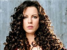 Spiral perms are flirty and can flatter your look. This spiral hair style pattern is obtained by using long perm rods which enable tight and cascading spirals/ringlets. #curls