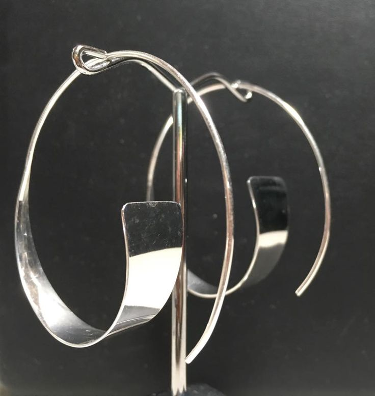 Stunning silver triangle hoops available in 5cm and 3.5cm