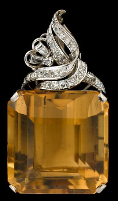 White gold, diamond and citrine pendant   mid 20th century   Large step cut citrine, prong set with pave set diamond bail.
