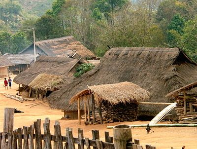 An Akha village, with the traditional thatched roofs, in northern Thailand.