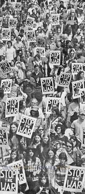 2,000 protesters march in silence against the Vietnam War along University Avenue in Champaign, Illinois, May 4, 1972.  Photo credit: Rob Glick — in Champaign, Illinois.