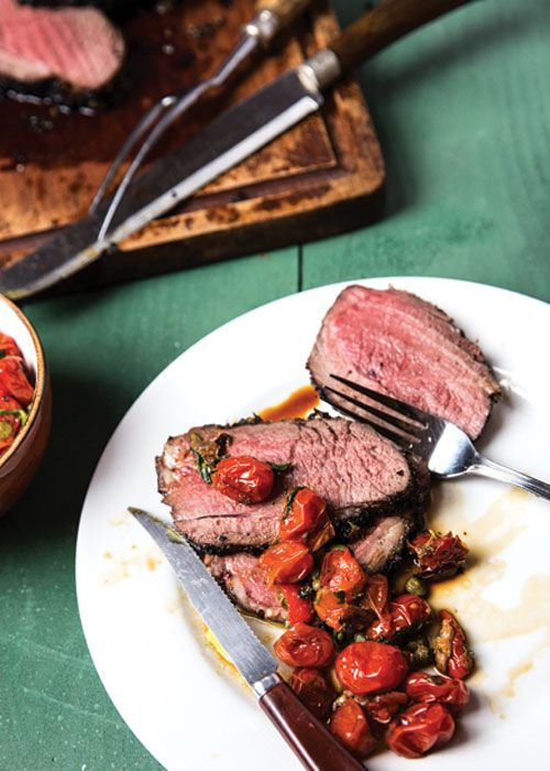 Succulent lamb entrecôte, a well-marbled boneless cut from the sirloin, is blanketed in a marinade of garlic, fresh marjoram, thyme, rosemary, and sage, which caramelize to form a flavorful crust as the lamb grills. At their Midsummer celebration in southern Sweden, writer Per Styregård's friends paired the lamb with a zesty umami-rich sauce of oven-roasted tomatoes, capers, and anchovies.