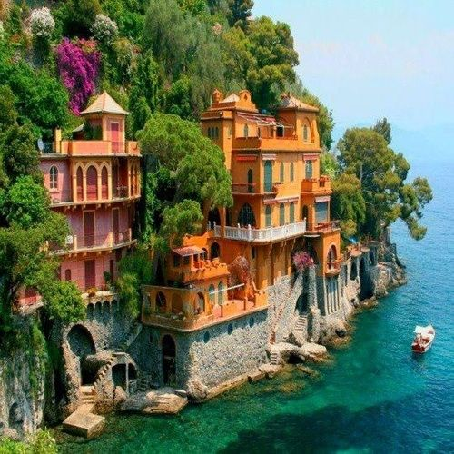 Saw this in a dream once. Freaked out when I learned it was real -- Portofino, Italy (urban nature architecture colorful vivid houses apartment complex by the ocean mediterranean cliffside houses landscapes building residency)