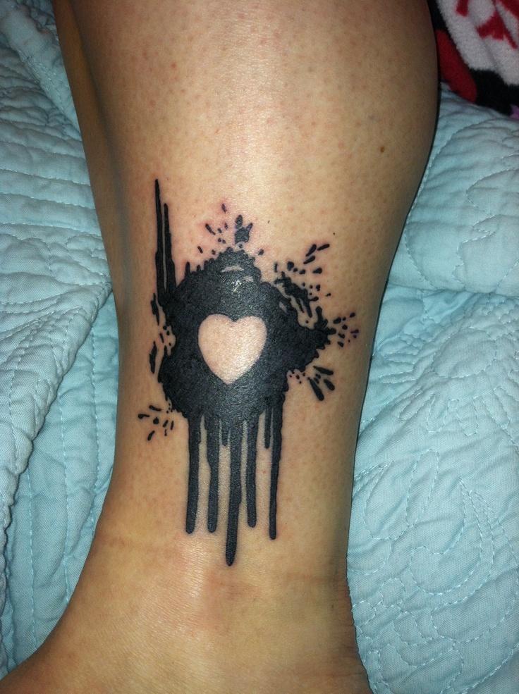 Paint splatter tattoo