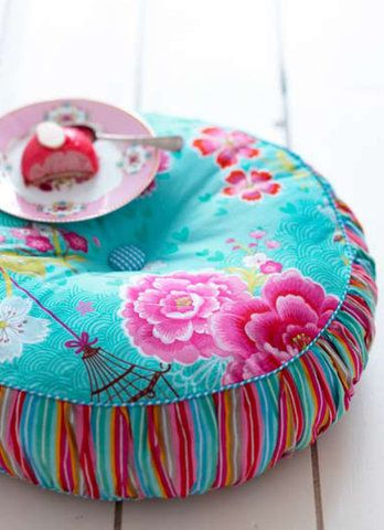 Inspiration for tuffet using gathered/striped sides; wrap onto plywood & add button feet. JFM
