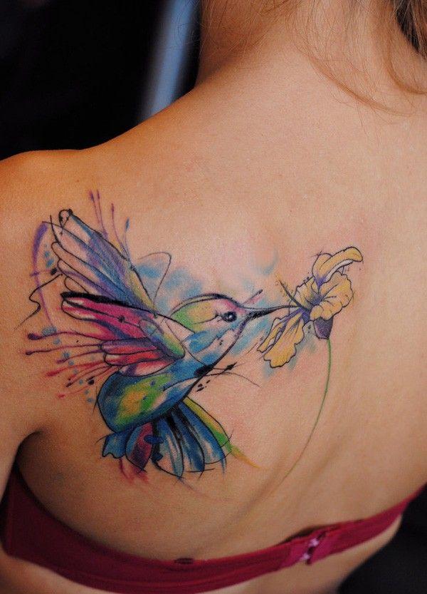 flying hummingbird watercolor tattoo on upper back - flower, bird, shoulder