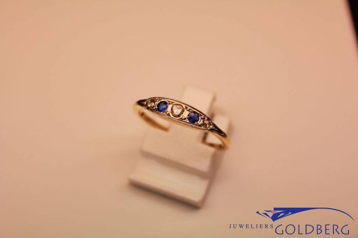 Exceptionally beautiful 18 carat gold antique ring set with diamonds (old cut) and sapphires. The ring bears hallmarks as used in Paris (France) between 1847 and 1919. The ring itself, given the style, dates from around 1900. For € 369,-. - Goldberg Juweliers http://www.goldbergjuweliers.nl/en/18-carat-gold-antique-ring-with-diamond-paris-184.html