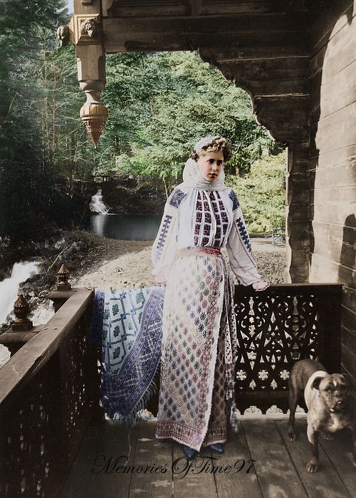 Colorized photo of Queen Marie of Romania was a granddaughter of Queen Victoria (1875-1938) and her bulldog. Pinned by Judi Crowe.
