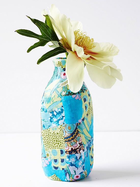 Pieced-Together Vase: Upcycle eclectic fabrics by decoupaging a pretty vase. Create your own papier-mache vase by choosing colors and patterns you love most for a one-of-a-kind patchwork centerpiece.