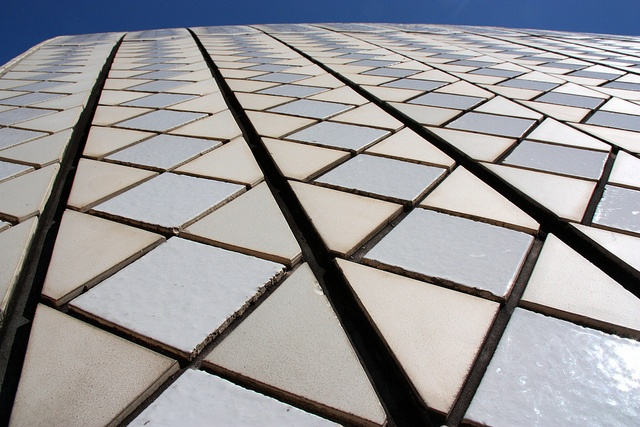 The Sydney Opera House facade has additive complexity. This forms from the tiles that are used as bricks or building blocks added over and over again to create a pattern.