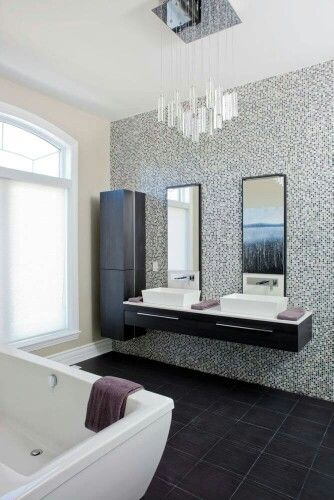 Floating Dark Stained Wood Vanity And Accompanying Vertical Cabinet Stand  On A Micro Tile Mosaic Wall Over Dark, Large Tile Flooring, Across From A  Large ...