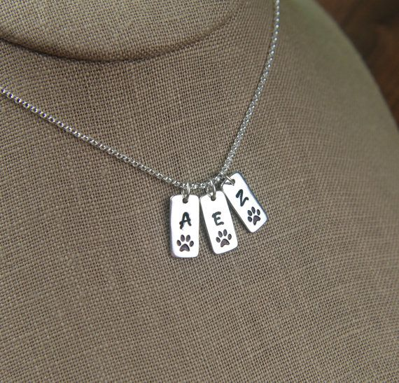 Sterling silver paw print tag with initial by jersey608jewelry