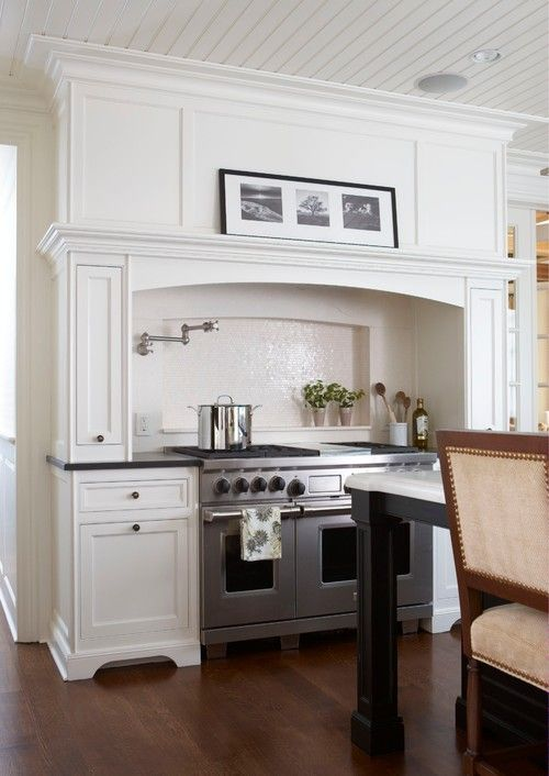 Hood | Daniel Contelmo Architects. I like the spice racks on the sides and the mantle hood on top. Very nice. Like the shelving behind for those little extras!