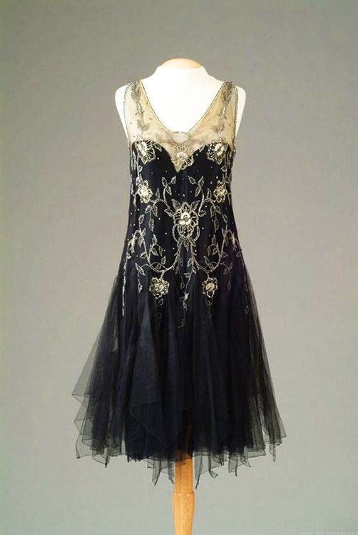 Gown of black netting with seed pearl and rhinestone embroidery in a floral design on the bodice. ca. 1926, The Meadow Brook Hall Historic Costume Collection.