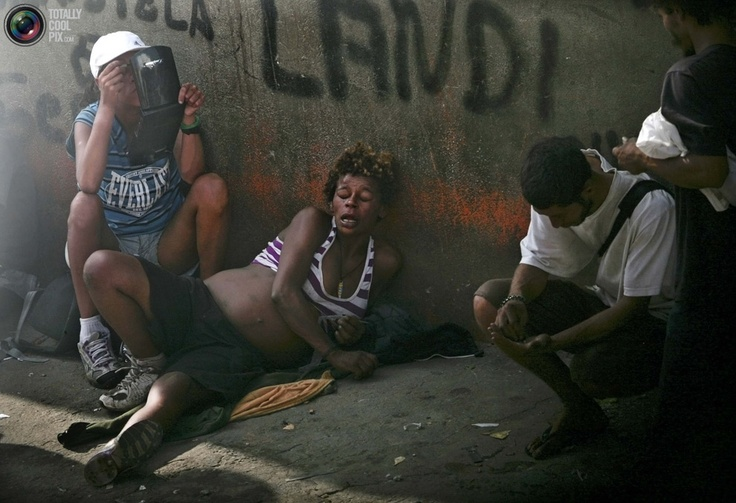 A pregnant woman smokes crack in the part of Sao Paulo's Luz neighborhood known as Cracolandia (Crackland), March 27, 2010