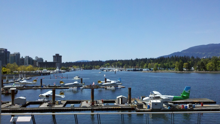 Sea planes in Vancouver Harbour with Stanley Park in the background - www.busswood.com