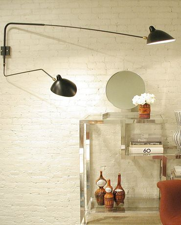 The long straight arm of this sconce is 69 inches allowing for illumination deeper into a room when needed while the shorter arm maintains lighting closer to the wall. Maximum flexibility is acheived with independently rotating arms and swiveling heads. Available in black or white with brass fittings