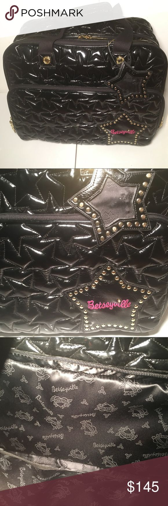 BETSEY JOHNSON Betseyville Black Patent Leather BETSEY JOHNSON Betseyville Black Patent Faux Leather Quilted Star Rolling briefcase/ carry on bag. Carry your stuff in style with this versatile bag by Betsey Johnson Betseyville. This is a buttery soft black faux leather rolling bag that could either be used as a carry on or laptop briefcase. It has a front zipper pocket large enough to hold a tablet and then some. Lightning bolt zipper pulls and a studded star luggage tag. There are two carry…
