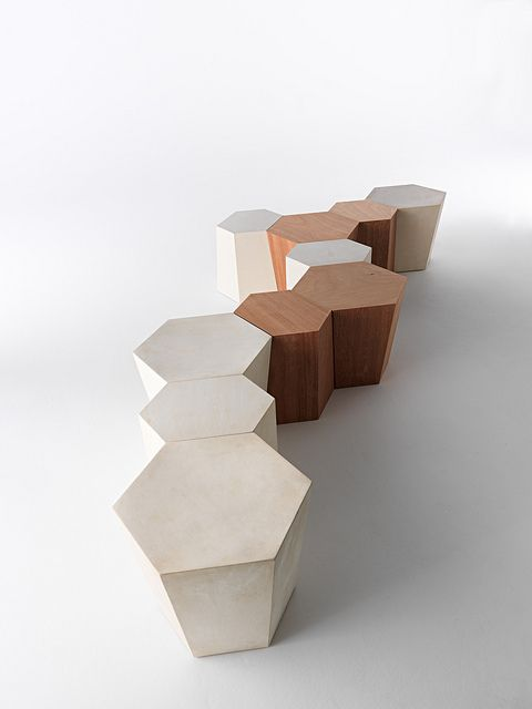 Hexagon / Design: Steven Holl, 2011 / Hexagon is a modular system composed of 2 irregular hexagons supporting each other, which allows for the creation of endless compositions. It can be used as coffee table, side table or stool, both indoor and outdoor. It is available in painted metal, Lecce stone or okoumè wood, withstands humidity and light rain. The Lecce stone is a limestone typical of the Salento region in South-East Italy, superbly suited to withstand severe weather conditions.