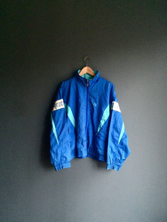 Size = Listed as a 4, fits like L  Label = Reebok  Condition = 10/10 Rare lightweight nylon Reebok jacket in bright blue nylon. Front full-zip