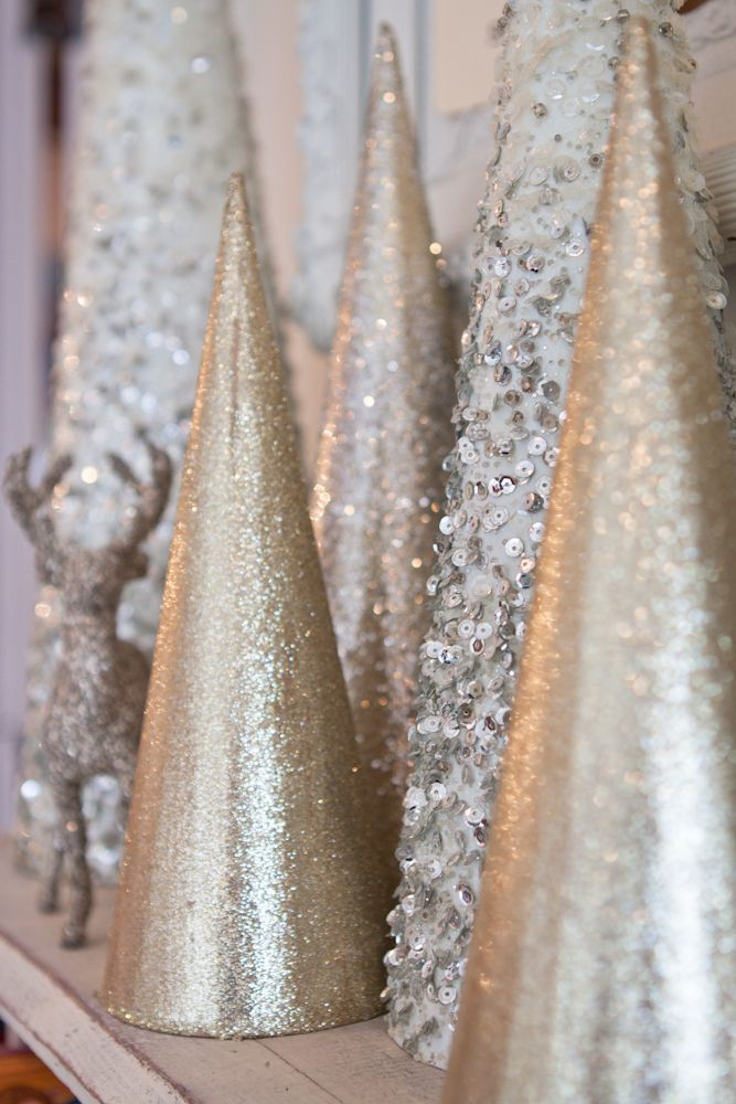 Pretty collection of sparkly trees - so festive for a winter mantel display!-use party hats