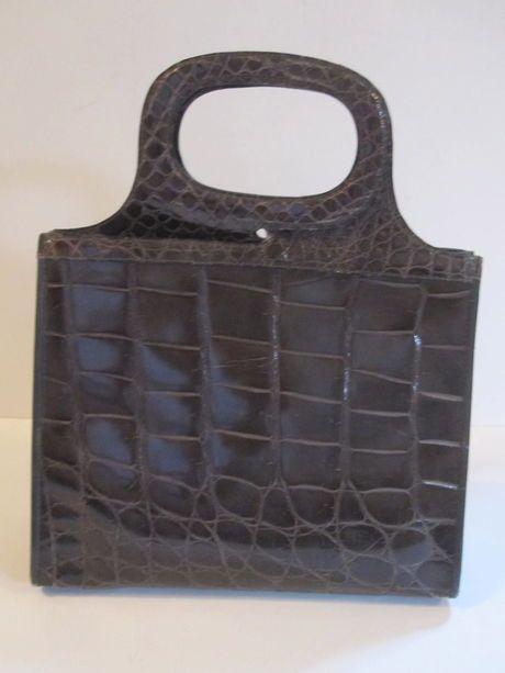 Shop my closet on @Jodie Guirey. I'm selling my Grey Skin Vintage Handbag Bag. Only $199.00