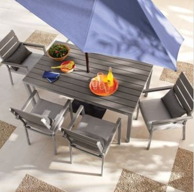 Create a sleek modern feel in your backyard with natural grey furniture.