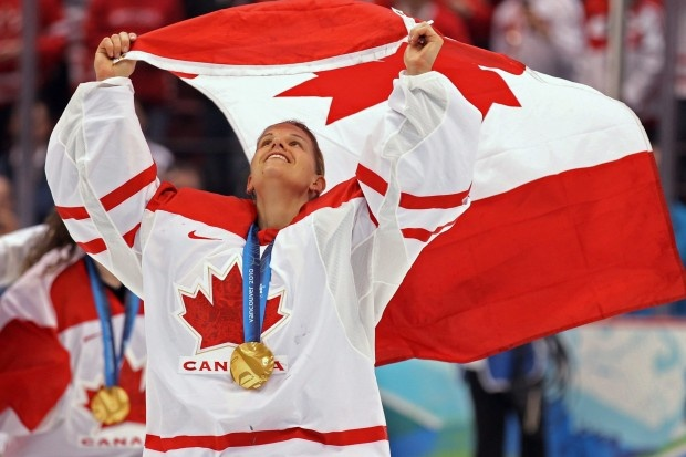 Canada's Kim St-Pierre waves the Canadian flag Thursday, Feb. 25, 2010 after defeating the USA 2-0 in the women's gold medal final ice hockey at the 2010 Winter Olympic Games in Vancouver | Official Site of the Canadian Olympic Team olympic.ca