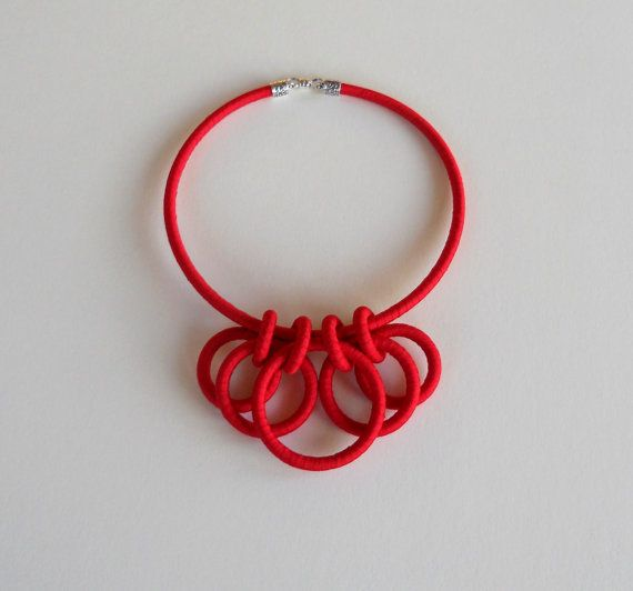 Patrice of fiber2love, Textile Statement Necklace Red $48.00 USD. Only 1 available. Handmade item Materials: ribbon, silver plated end cap, magnetic clasp, nonlatex tubing.  The collar measures 18 inches around and is narrower than my larger collar necklaces at only 3/16 of an inch thick.