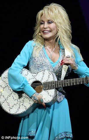 Huge hit: Dolly has been wowing audiences around Australia after kicking off her tour last week.  Dolly Parton, 68, accentuates her tiny waist in a glittering gold vest as she takes to the stage for Blue Smoke tour | Mail Online