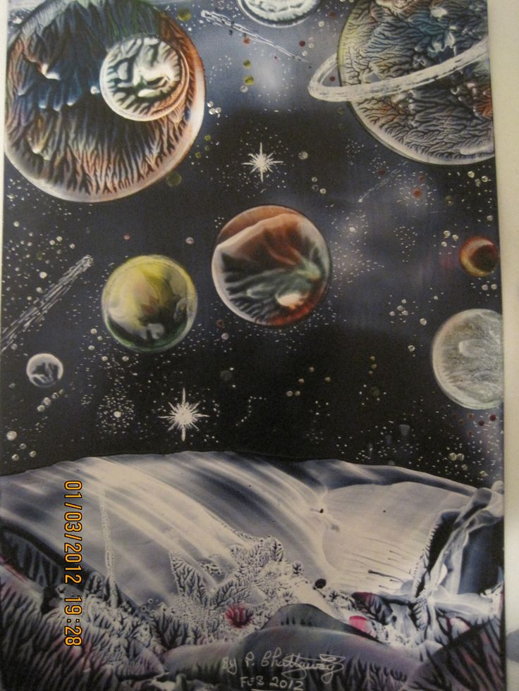 The Planets,size A6,using beeswax melted onto a travel iron and onto a glossy card.By Peter Chattaway.2012