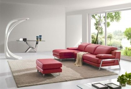Leather Lounge with adjustable head rests and stunning metal features.