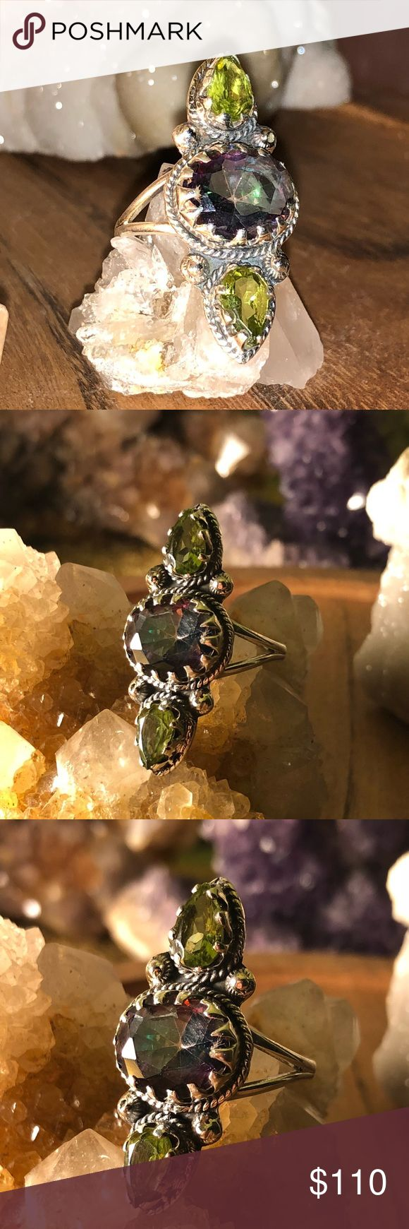 Rainbow Topaz & Peridot 925 sterling silver 6.5 🌙 Boho Rainbow Topaz & Peridot 925 sterling silver 6.5 🌙 this ring is absolutely stunning and a definite eye catcher, the rainbow topaz flashes many colors almost like an oil spill set in between two green peridots set 925 stamped sterling silver detailed setting size 6.5 Handcrafted one of a kind ring that will add to any outfit . Jewelry Rings
