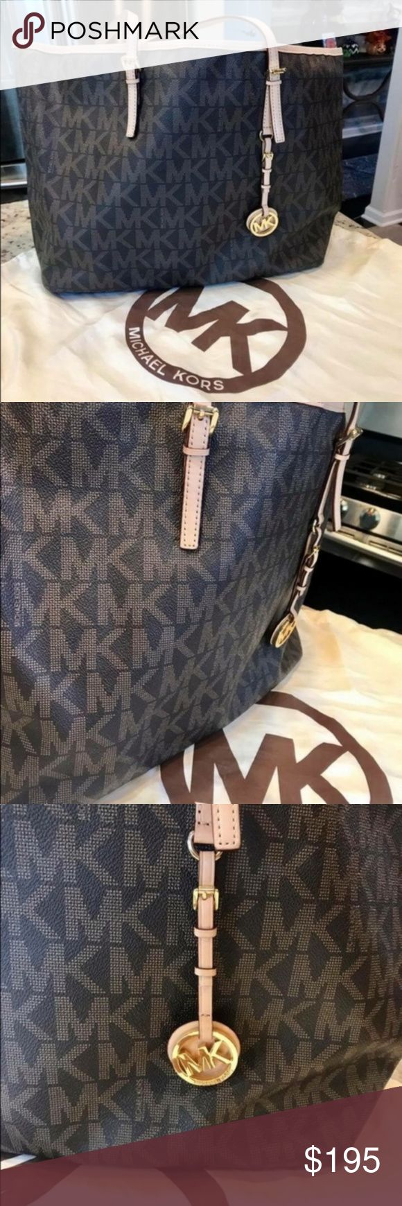NWT Michael Kors Jet Set Signature Large Tote NWT Michael Kors Jet Set Signature Large Tote. New with tags! Brown color, creme colored straps, gold hardware; MK logo present; open to offers! doesn't come with the dust bag; Michael Kors Bags