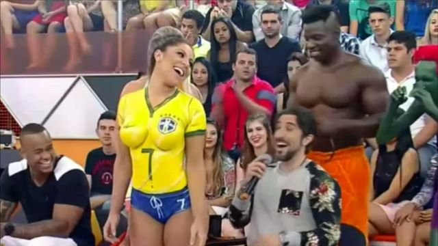 Man In Awe Of Woman's Body Paint During This Strange Brazilian Game Show