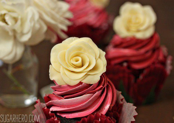 Chocolate Rose Cupcakes feature chocolate-rose cake, rose-vanilla bean buttercream, and gorgeous edible white chocolate roses on top!