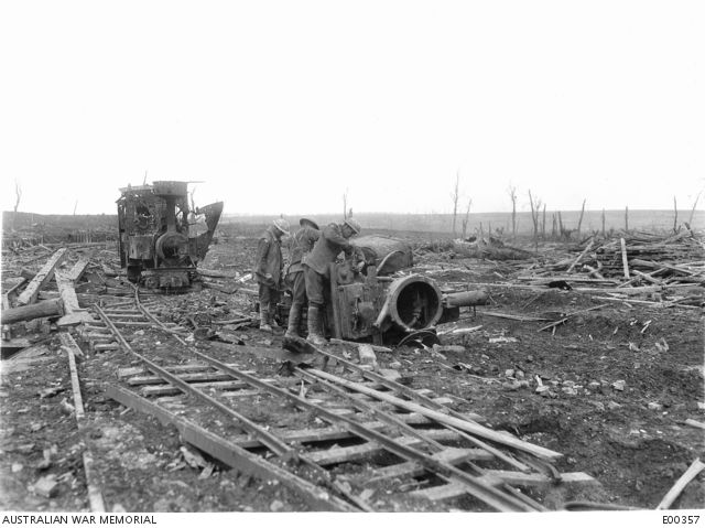 Rolling stock left by the Germans at Le Sars in March 1917. Members of the 2nd Australian Divisional Engineers removing parts that will be useful later.
