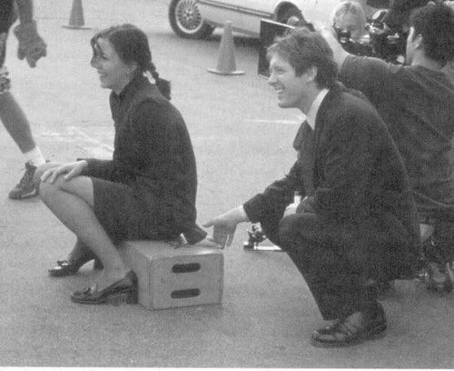 Maggie Gyllenhaal and James Spader during the filming of Secretary