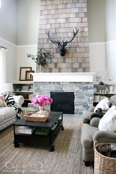 This neutral shade of Behr Wind's Breath brings out the beautiful, natural wood tones of this DIY shingle fireplace. See how BEHR can transform your living room with just the right coat of paint today. |@jonesdesignco.