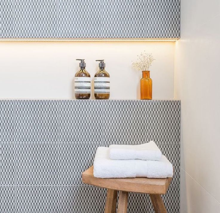 Love the nook  - size, different white tile inside, and the lighting