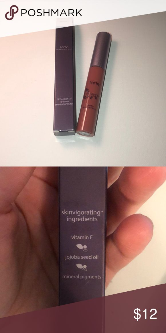 NWT Tarte LipSurgence Lip Gloss Exposed NWT Tarte LipSurgence Lip Gloss in shade Exposed. Brand new, never opened!   Photo of online lip swatch included. Make an offer or ask questions if interested! tarte Makeup Lip Balm & Gloss