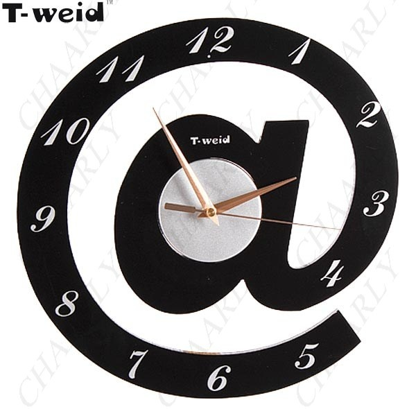http://www.chaarly.com/clocks/60948-t-weid-wood-glass-novel-logo-shaped-mute-art-wall-clock-for-living-room-bedroom-1-x-aa.html