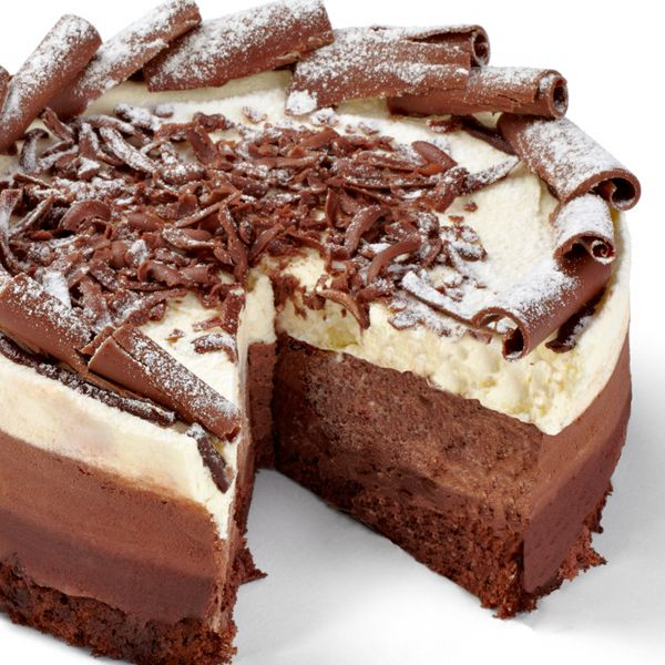One cake layer recipe, two mousse layer recipes and a fancy topping to make your guests swoon.. Gourmet Chocolate Layer Dream Cake Recipe from Grandmothers Kitchen.