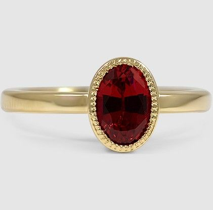 This Yellow Gold Sapphire Sierra Ring is set with a ravishing lab created ruby.